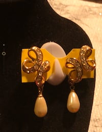 Gold tone pierced earrings with faux teardrop pearl and rhinestones Patchogue, 11772