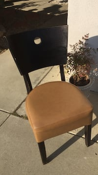 Brown leather padded black wooden frame chair