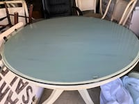 Pier 1 glass top table w/4 chairs 286 mi