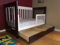 brown wooden bed frame with text overlay Edmonton, T5G 2T8