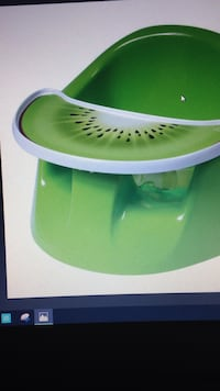 Green bumbo chair with tray and place mat Mississauga, L4W 0A5