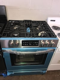 Slide In gas stove new 30in Frigidaire stainless steel 6 months warran Pikesville, 21208