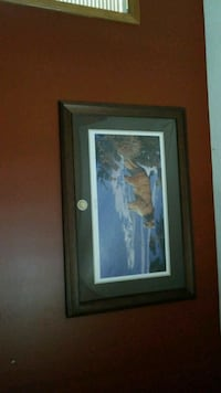 brown wooden framed painting of woman Calgary, T3J 3V3