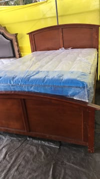 brown wooden bed frame and white mattress Bakersfield, 93307