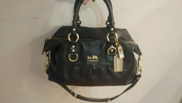 Black and gold Coach purse