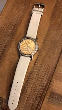round silver-colored analog watch with white leather strap Montréal, H1R 3A7