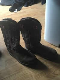 pair of black leather cowboy boots London, N6B 2J6