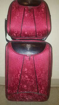Matching red heart luggages