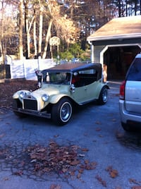 1973 dune buggy maxi taxi.yellowish color stick shift roof does come off two bucket seats rear bench seat plastic windows that snap on green pinstriping front rear and sides of car, engine so clean you can eat off it odometer needs to be replaced has 888 Billerica