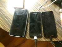 space gray iPhone 6 and two black smartphones 1462 mi