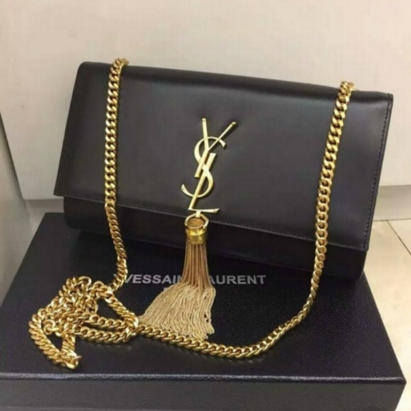 Used black Yves Saint Laurent leather sling bag with box for sale in London  - letgo 4e20d6e73496a