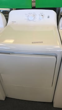 white Hotpoint front-load clothes washer