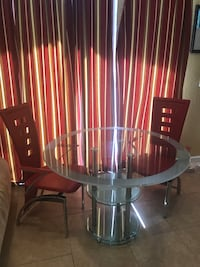 Tempered Glass dinning or nook table with two leather chairs Palm City, 34990