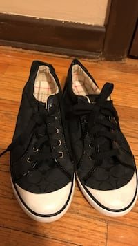 black-and-white Coach low-top sneakers