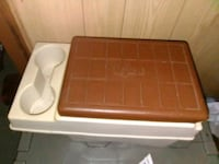 brown and white plastic ice chest  Houma