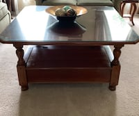 Solid cherry square coffee table 40 x 40. Comes with glass protector. Table has storage underneath Walpole, 02081