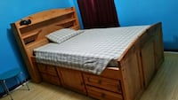 brown wooden bed frame with white mattress Tallahassee, 32308