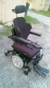 red and black electric wheelchair 303 mi