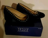 Black heels with eyelet design/Giselle St. Louis, 63123