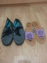pair of gray plimsolls; brown-and-purple flat sandals