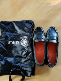 pair of black leather loafers 560 km