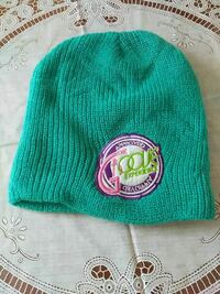 green, white, and pink knit cap