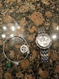 like new guess watch,new silver bracelet and ring,