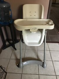 baby's white Evenflo high chair with plate