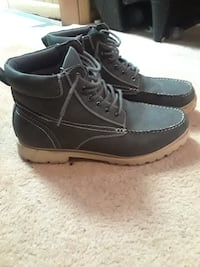 pair of grey leather boots