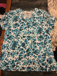 White, blue and gray floral scrub suit top