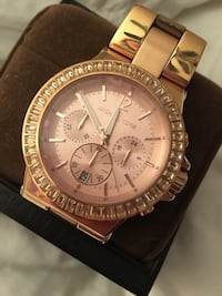 Round gold-colored michael kors chronograph watch with gold-colored link bracelet