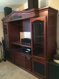 Cherry wood entertainment center w lights and beveled glass doors. Breaks down into 6 parts for moving. Expandable, moving must go  Rosamond, 93560