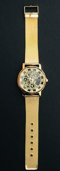 round gold chronograph watch with yellow strap Providence, 02906