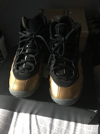 gold-and-black nike air foamposite  New York, 10027