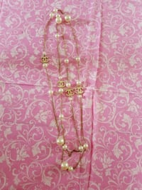 gold-colored chain necklace with cross pendant Riverview, E1B 1J4