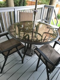round glass top table with four chairs patio set Washington, 20012