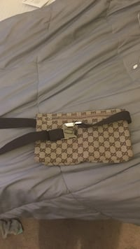 Brown and black monogram gucci leather belt