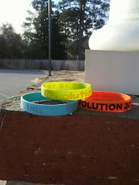 three green, orange, and teal silicone bands