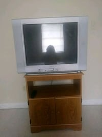 gray CRT TV with brown wooden TV stand Pharr, 78577