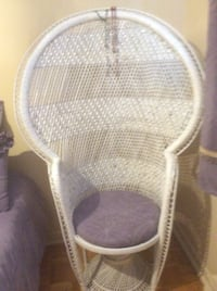 White wicker chair with pillow