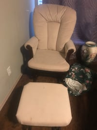 Brown wooden framed cream/ beige padded glider chair