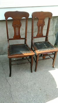 two antique  brown wooden chairs