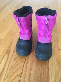 pair of pink-and-black front-zip sheepskin winter boots Montréal, H3S 2M7