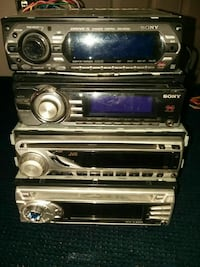 two black and silver 1-DIN car stereo head units Bellefonte, 16823