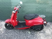 red and black motor scooter Henderson, 89011