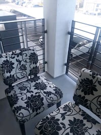 two white-and-black floral padded chairs Las Vegas, 89130