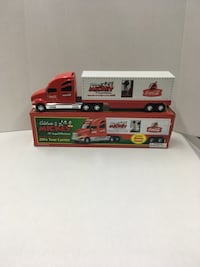 2001 red and white Tour Carrier scale model with box