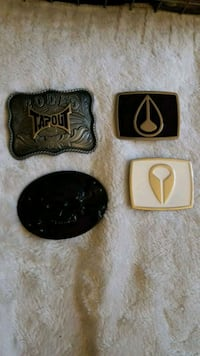 four assorted belt buckles