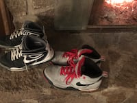 Two pairs of gray and black nike basketball shoes