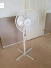 white and gray pedestal fan